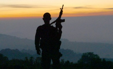 Silhouette of man with rifle
